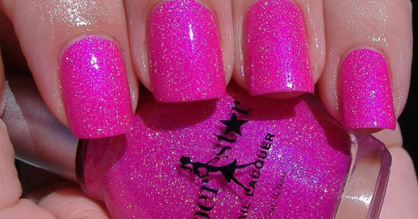 Hot pink sparkly nail polish