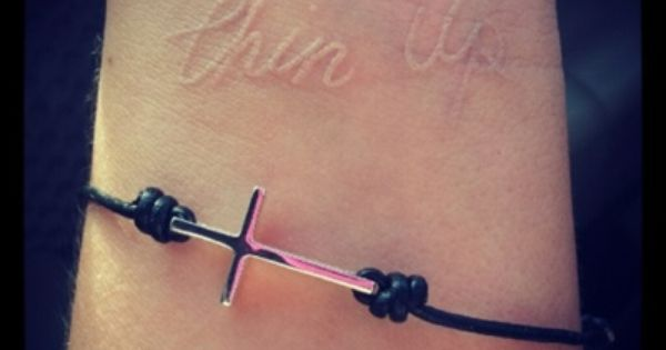 Chin up white tattoo and cross bracelet