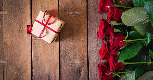Bouquet of red roses on a dark wooden background