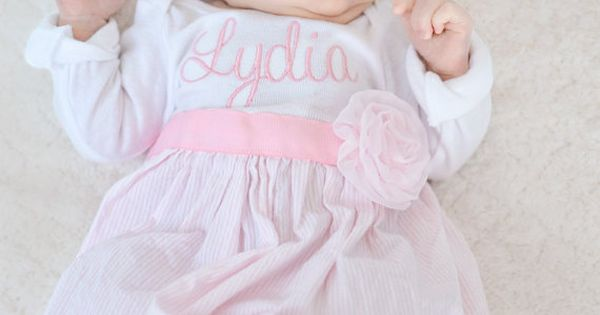 Beautiful coming home baby gown with headband and flowers.