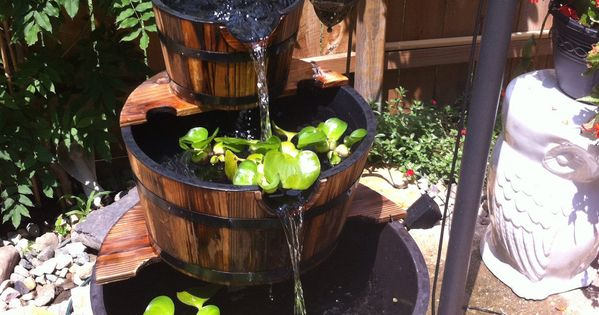 This 3 Tier Wooden Whiskey Barrel Outdoor Patio Water