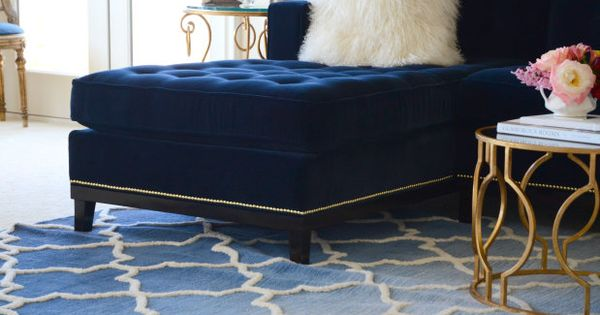Brass nail heads on a tufted couch formal living room for Navy blue carpet living room