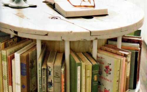 DIY Factory spool table with dowels for book storage- perfect for a