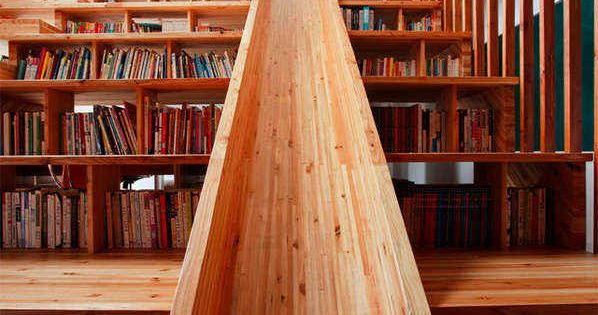 Architect Moon Hoon designed the Panorama House in South Korea, which features a multi-functional library. A wooden slide (used by the adults in the home, too!) is flanked by stair step bookcases ideas library pinterest