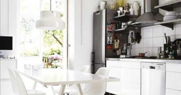 white kitchen. Eames chairs