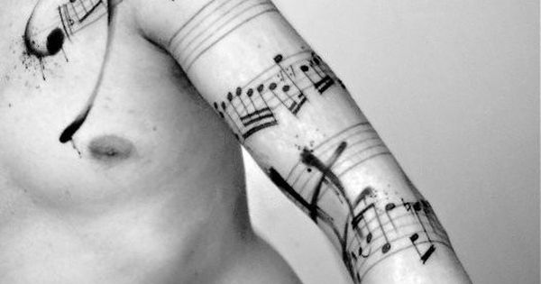 Wonder if it's a real song? Music sheet tattoo.