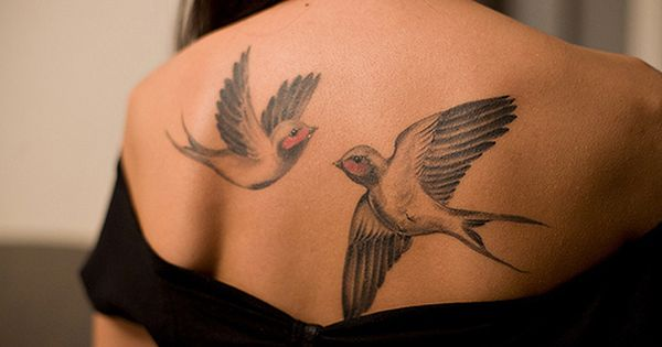 a tattoo of two birds
