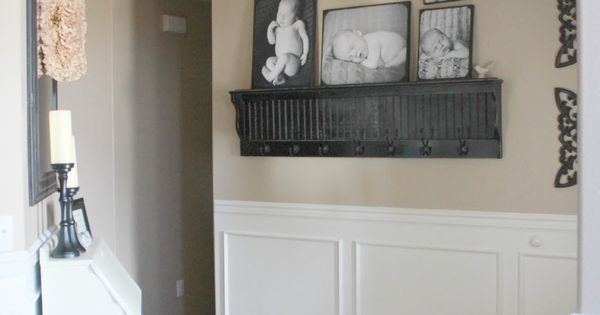 entry wall narrow ledge with hooks for guest 39 s coats and framed pics. Black Bedroom Furniture Sets. Home Design Ideas