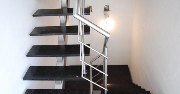 Een inox open trap met centrale trapboom en donkere treden in natuursteen trappen pinterest - Ontwerp betonnen trap ...