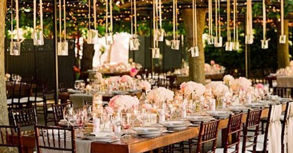 outdoor reception with hanging candles