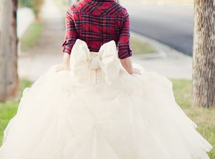 plaid shirt topping a wedding dress for a country wedding