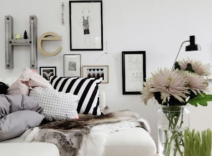 Monochromatic, black and white living room. White sectional sofa with loads of