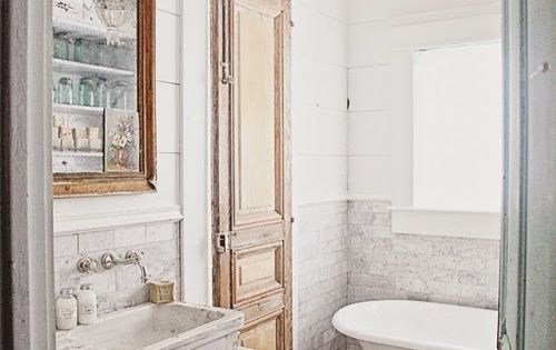 Dreamy whites french inspired bathroom remodel carrera for Old tile bathroom renovation
