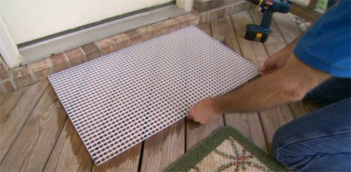 Use A Fluorescent Light Grid Under Your Welcome Door Mat