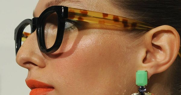 thick glasses, statement earrings and poppy lips