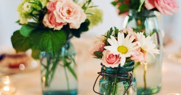 Dainty flowers in mason jars