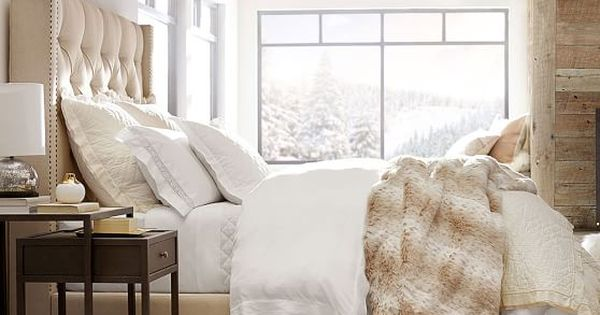 Pottery barn 39 s harper upholstered bed mountain chic faux for Fur headboard
