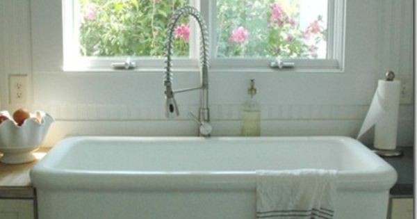 love the skirted farm sink ... so pretty and so practical ... and that ...
