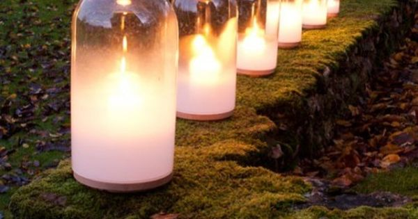 Glass bottle candle covers look classy and keep your outdoor lighting from