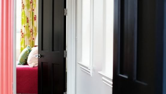 Black interior doors, white walls, crystal door knobs