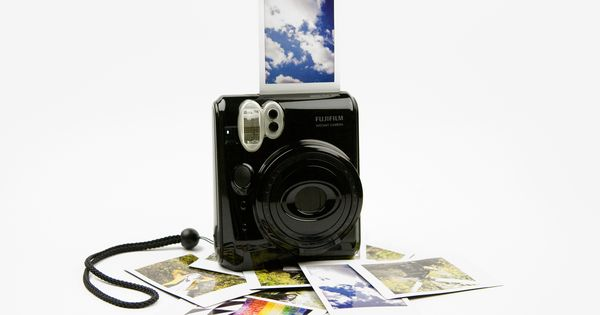 The Fuji Instax Mini 50s Piano Black (fuji's version of an instant