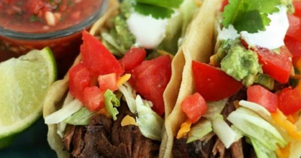 Easy, tender, amazingly delicious slow cooker Shredded Beef Tacos. This beef can