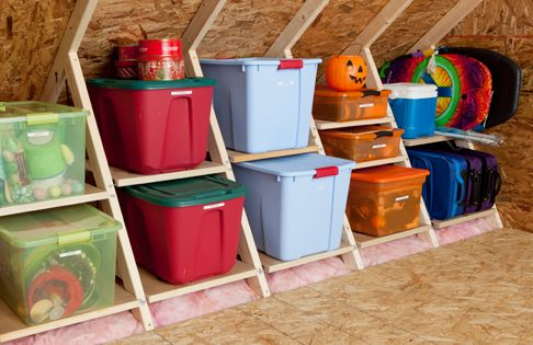 Interesting attic space storage idea but love the color coded seasonal tubs