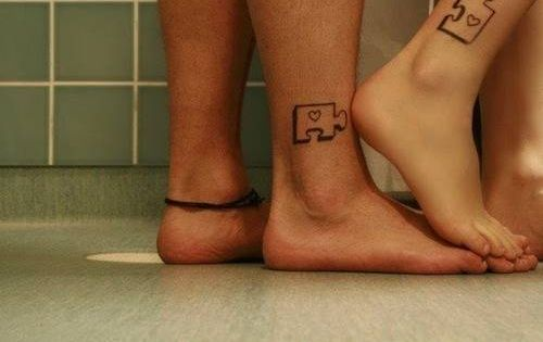 couple's tattoos. puzzle pieces. such a cute idea!
