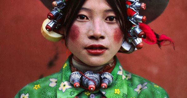 Portrait of a young girl, Tibet. Photographed by Steve Curry. photography color