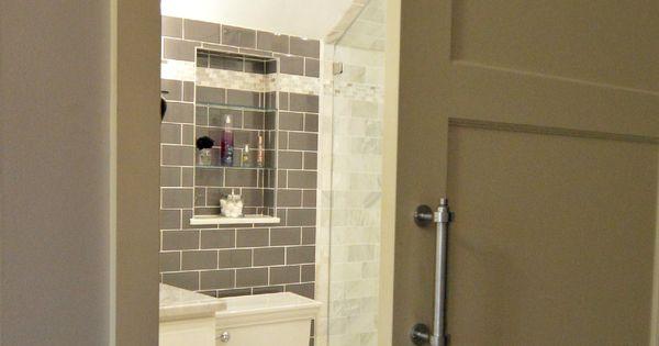 tiny bathroom remodel features glass tile wall  carrara