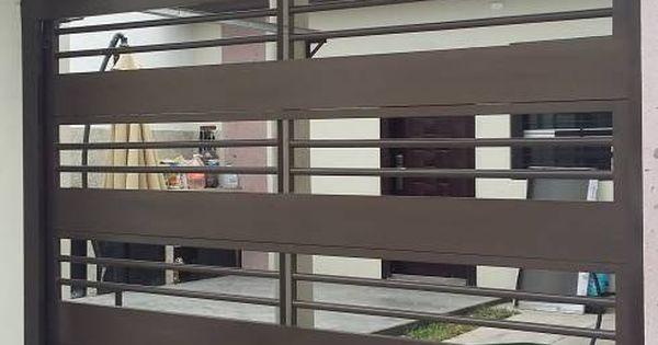 15 puertas de exterior que impresionar n a toda la cuadra for Garajes modernos interiores