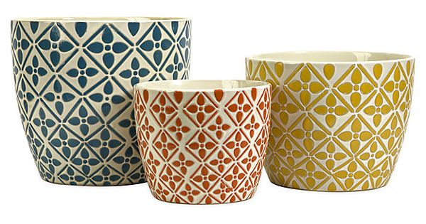 Bright colors and bold graphic patterns define the Kelly Bright Planters. These