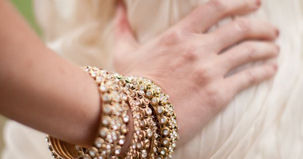 glamorous stacks of bangles by www.chamakbypriya... Photography by mthreestudio.com