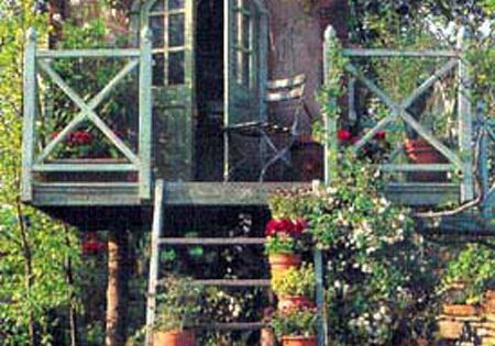 This garden tree house would make a great garden shed.