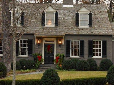 Love The Dark Gray Paint With Dark Shutters Beautiful Brick Exterior House Exterior Brick House Exterior