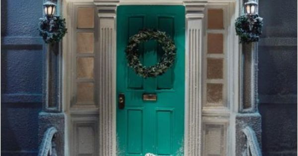 tiffany blue front door n moldings n the staircase. we can just