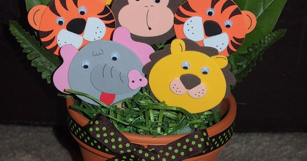 Adorable Jungle Theme Baby Shower Centerpiece. Alter cutouts to include more animals.