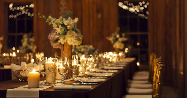 Twinkle lights, candles, estate seating and rustic decor in this romantic wedding
