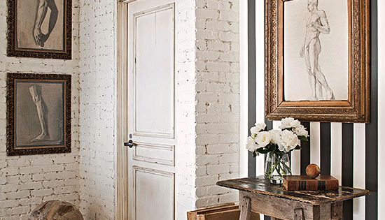 Textured, aged white brick, rustic table and diagonal planked floor, mixed with
