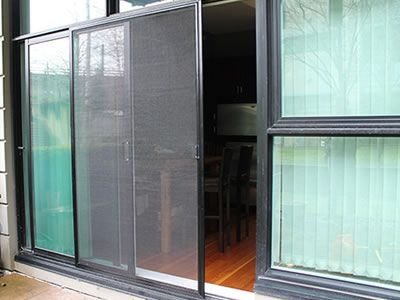 Sliding Fly Screen Is Applied On A Glass Door In Order To Repel
