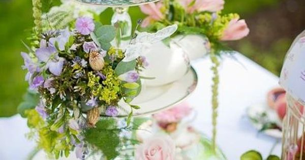 Teaparty centerpiece. Round mirror set on table, topped w/ 2 tier servers