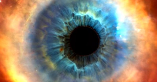 This is a cool mixing of an eye and the Helix Nebula ...