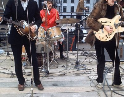 The Beatles performing on the roof of the Apple building for 'Let