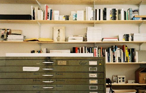 Home Office Space with plenty of shelving for your books & a