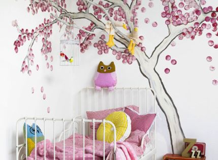 Beautiful little girls room with fabulous tree mural