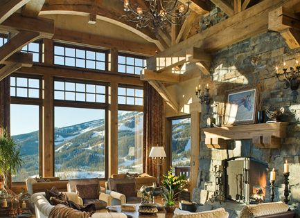 beamed ceilings and big windows.. wouldn't mind the view either! mountain house?
