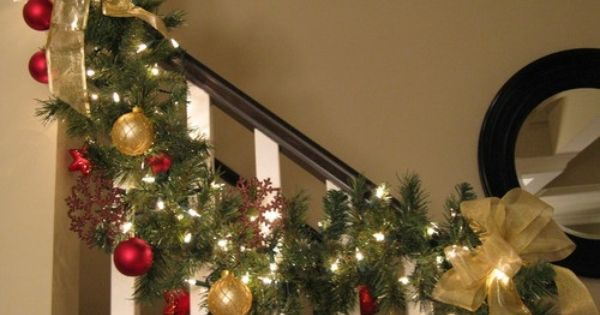 Close Up Of Stair Garland Small White Lights Wired Gold Ribbon Red And Gold Balls Christmas Stairs Christmas Banister Christmas Garland On Stairs