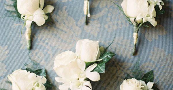 Elegant white boutonnieres. wedding flowers boutonnieres