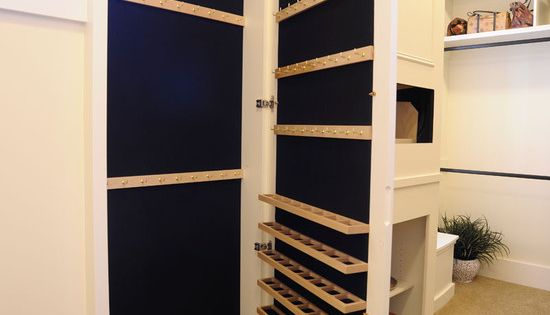 Hidden jewelry closet behind a full length mirror (master closet)