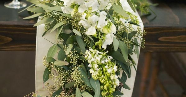 Loving these table runners instead of a centerpiece. Seeded eucalyptus garland
